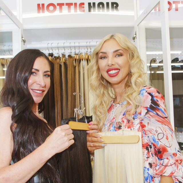 Hair Stylist Showing Russian Clip In Hair Extensions in Las Vegas at Hottie Hair Salon and Hair Store Las Vegas
